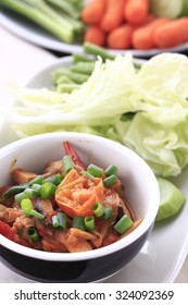 tomato spicy dip with fresh vegetable. vegetarian dip made from tomato and mushroom serve with fresh vegetable. Northern thai tomato spicy dip. thai style tomato spicy dip.