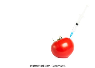 Tomato and syringe with toxins isolated on white background. The concept of GMOs, laboratory studies, toxins, etc.