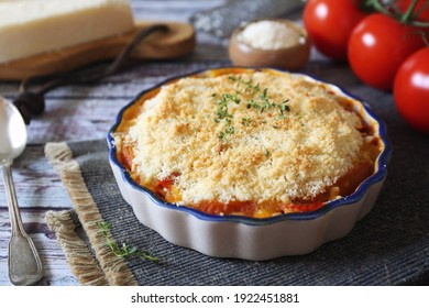 Tomato vegetable crumble with aromatic herbs and grated parmesan cheese