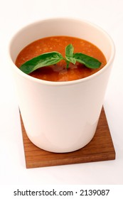 tomatoe soup with basil in white cup