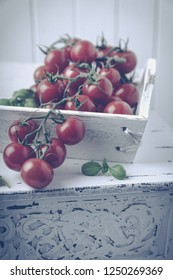 Tomatoes and basil in a white shabby chic decoration