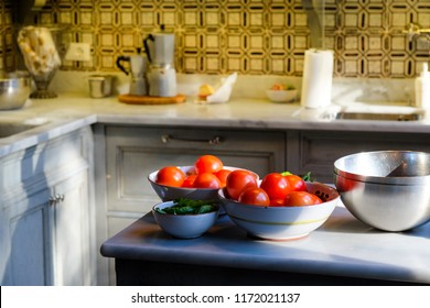 Tomatoes in a bowl on a counter in an Italian kitchen in Florence, Italy