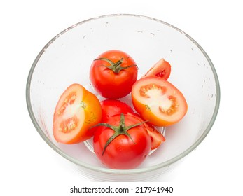 tomatoes in bowl on white background