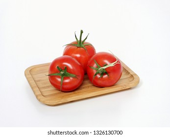 Tomatoes, bush tomato with stalk on a wooden board.