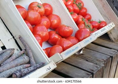 Tomatoes and carrots at farmer market