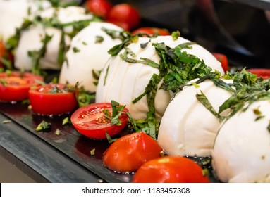 Tomatoes with cheese in a restaurant