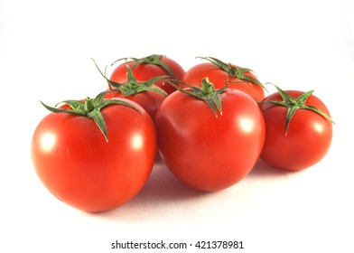 Tomatoes close up on a white background