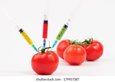 Tomatoes with different color syringes in one of them