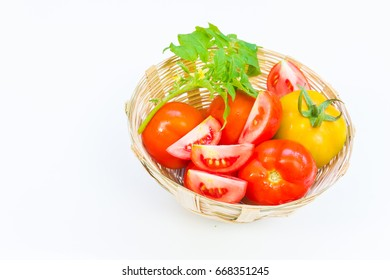 Tomatoes so fresh in basket on white background
