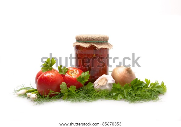 Tomatoes. Glass jars with tomatoes.