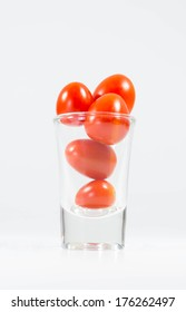 tomatoes in glass on isolated