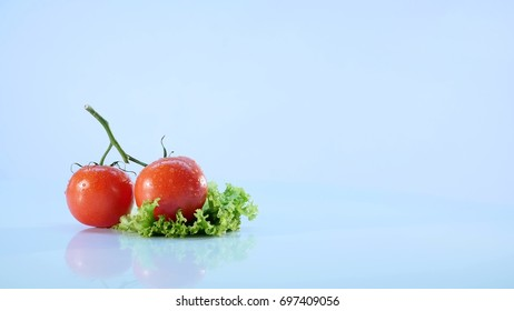Tomatoes isolated on white background.Brunch of tomatoes rotating .