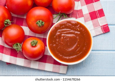 Tomatoes and ketchup. Top view.