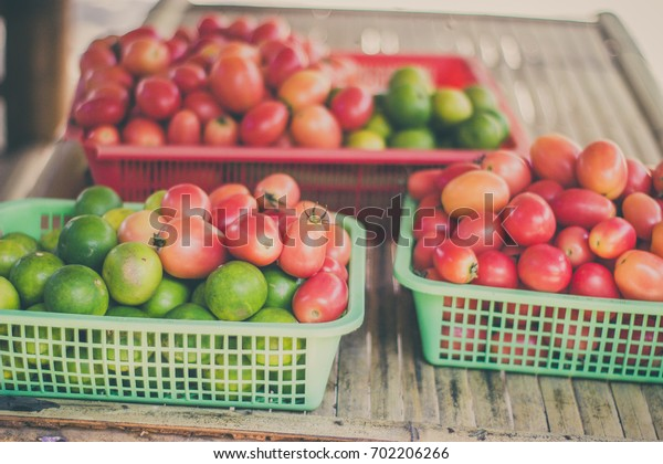 Tomatoes and lemons in a basket