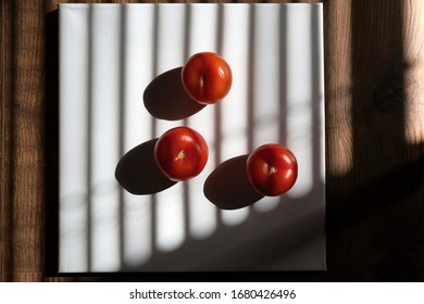 Tomatoes in natural light on background