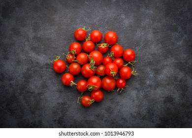 tomatoes on black background.