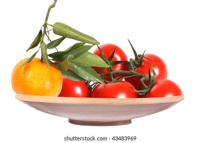 Tomatoes  on a dish on a withe isolated background with copy space (with clipping path)
