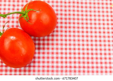 Tomatoes on a plaid background