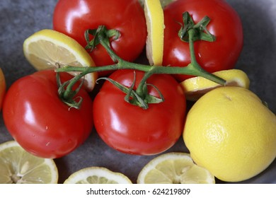 Tomatoes on the vine with lemons