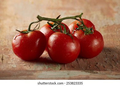 tomatoes on vine with wood background