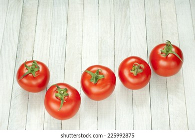 tomatoes on white wooden table