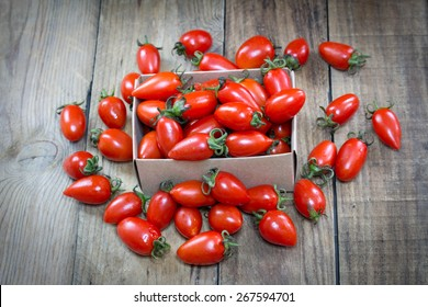 tomatoes on wood background