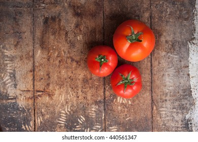 tomatoes on wooden background,top view.