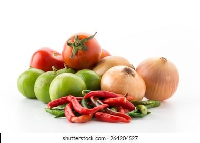 tomatoes, onions, green lemons on white
