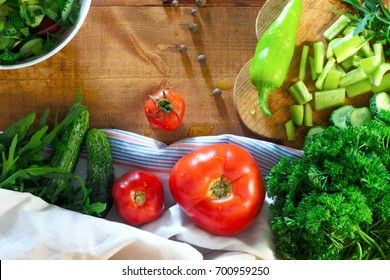 Tomatoes, pepper, parsley, cucumber on rustic wooden background