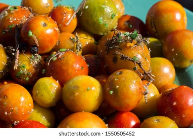 Tomatoes seasoned with spices and olive oil