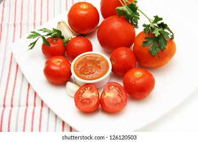 Tomatoes and tomato sauce with garlic and parsley