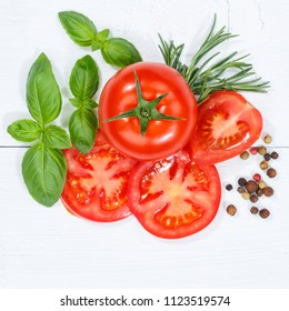 Tomatoes tomatos vegetables with basil from above square wooden board wood