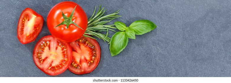 Tomatoes tomatos vegetables with basil from above banner slate copyspace copy space