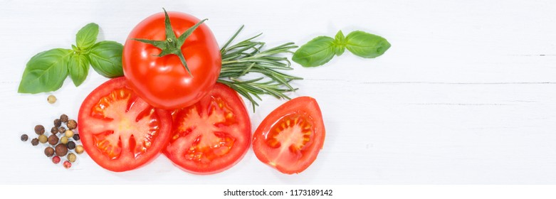 Tomatoes tomatos vegetables with basil from above banner copyspace copy space wooden board wood