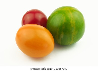 Tomatoes of various shape and color on white background