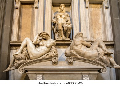 Tomb of Giuliano de Medici and below lying on the sarcophagus  Michelangelo's sculptures 'Night and Day'.