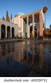 Tomb of Saadi the famous Persian poet and its reflection on wet floor shot with warm orange filter after a shower rain on a sunny day.