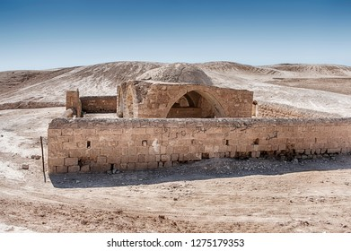 A tomb with a surrounding wall made of stone stands in the middle of the Negev Desert In Israel.