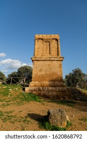 Tomb of Theron in Valle dei Templi in Agrigento with remains of the temple of Heracles in background, Sicily, Italy