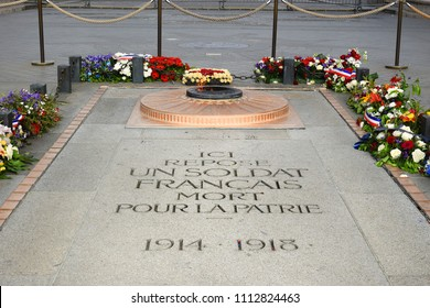 tomb of the Unknown Soldier at the base of the Arc de Triomphe at the center of Place Charles de Gaulle in Chaps Elysees, Paris, France
