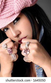Tomboy with bling.   Focus is on the rings