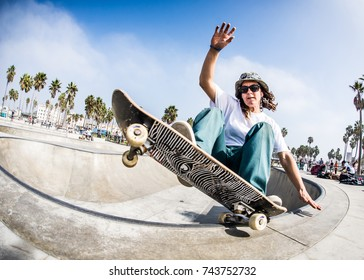 Tomboy Girl Skateboarding in Venice Beach