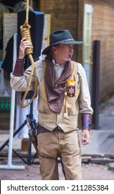 TOMBSTONE , ARIZONA - AUG 09 : A participant in the Vigilante Days event in Tombstone , Arizona on August 09 2014. Vigilantes dedicated to keeping the historical town of Tombstone alive