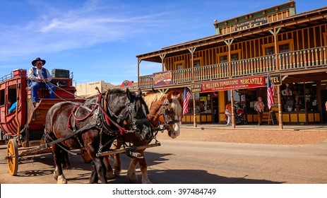 TOMBSTONE, ARIZONA - MARCH 20: A stagecoach filled with tourists travels the historic streets of Tombstone, Arizona on March 20th, 2016.