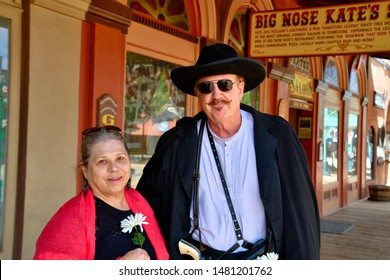 Tombstone, Arizona / USA - 11 August 2019 Doc Holliday impersonator and actor with a mature woman.