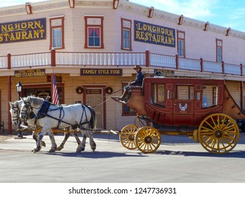 Tombstone, Arizona, USA - DEC 3, 2011: Historic Allen street with a horse drawn stagecoach in Tombstone. Built near the Goodenough Mine Tombstone became a boomtown in the American frontier.