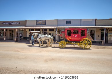 Tombstone, Arizona, USA - May 1, 2019: Stagecoach and Wild West style storefront facades on the streets of historic Tombstone. The ghost town destination draws over 400,000 tourists annually.