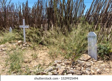 Tombstone, Arizona, USA - May 1, 2019: Graves and markers at the famous Boothill Graveyard in Tombstone Arizona. The cemetery contains the graves of many of Tombstones infamous outlaws and lawmen.