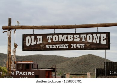 Tombstone, Arizona / USA - November 11, 2019 - A sign showing Old Tombstone Western Town.  The sign has a skeleton of a person hanging and the skeleton of a buzzard looking down at the person hanging.