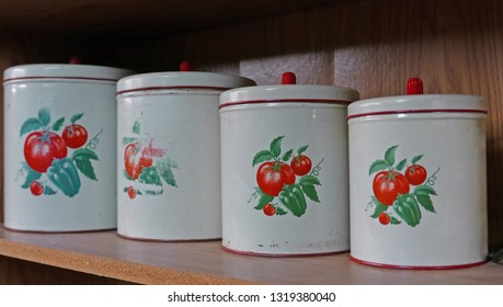 Tombstone, Arizona/USA - February 8, 2019: Different size vintage food storage containers with a tomato motif